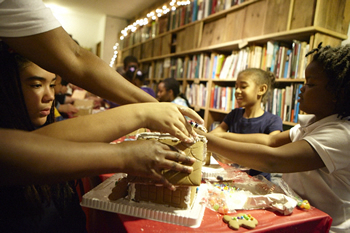 Rebuild Foundation kid making gingerbread house