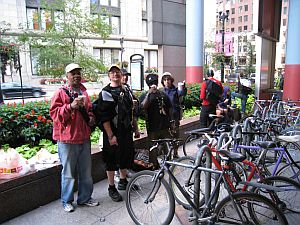 bike messengers enjoy coffee and donuts at the JR Thompson Center