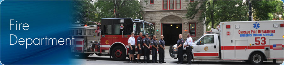 Fire Department Employees in front of Firehouse and vehicles