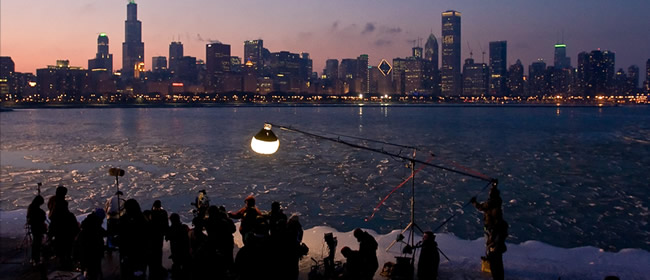 Movie crew filming along Lake Michigan with Chicago skyline in the background (Photo credit: Chuck Hodes)