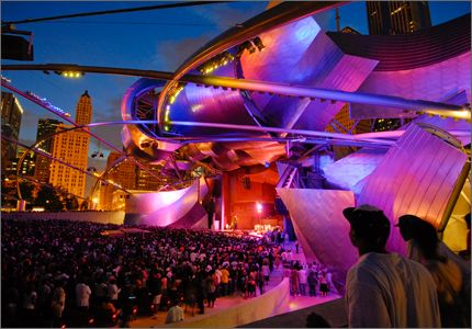 The Jay Pritzker Pavilion is illuminated for a nighttime performance
