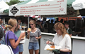 Festival-goers eating at the Taste of Chicago