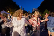 Friends dancing at Chicago SummerDance in the Spirit of Music Garden in Grant Park