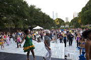 Dance instructors giving a dance lesson at Chicago SummerDance in the Spirit of Music Garden in Grant Park