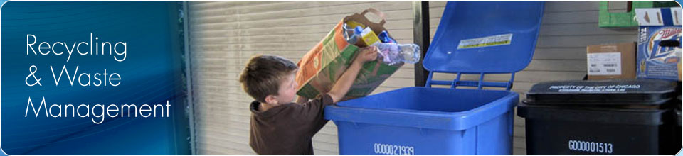 Image of a young boy putting recyclable materials into a Blue Cart for recycling