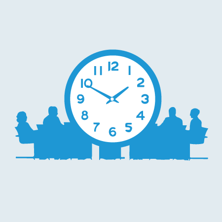 people at a meeting table and large clock