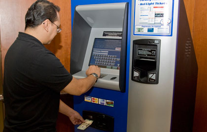 A Customer Pays A Bill At A Chicago EZ Pay Station