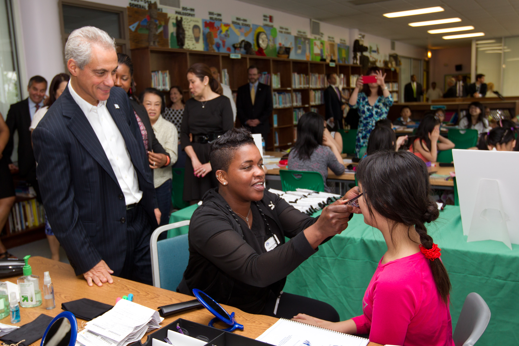 Mayor Emanuel visits with students receiving free eye glasses at Haines Elementary.