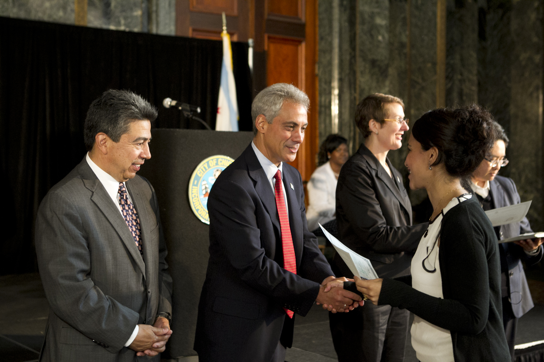 Mayor Emanuel congratulates newly naturalized citizens representing 32 countries at the Chicago Cultural Center.