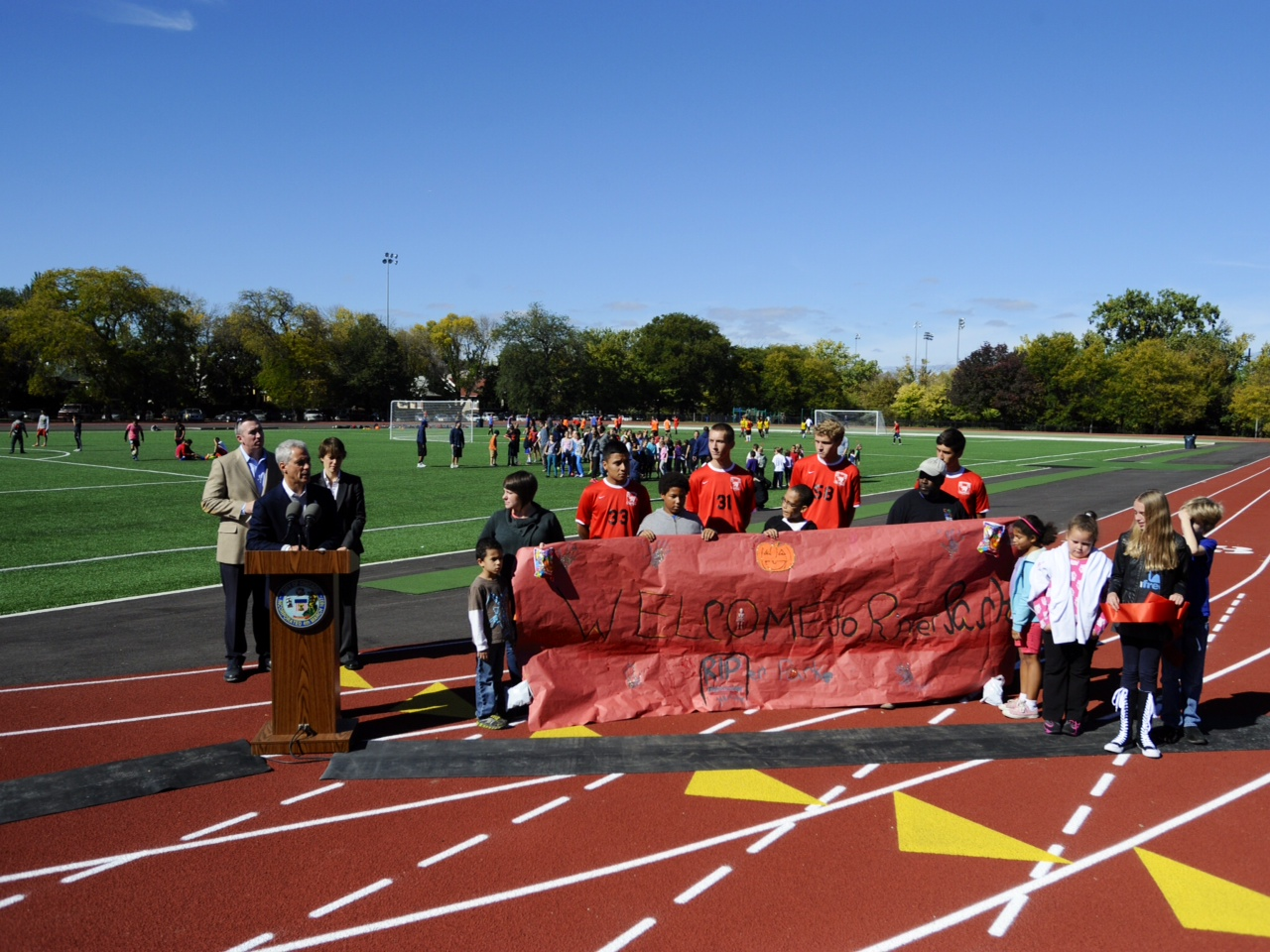 Mayor Rahm Emanuel, Alderman Deborah Mell (33rd Ward) and members of the Lincoln Square community gathered today at the site of a new artificial turf field and running track at River Park to highlight on going investments being made in the Lincoln Square community.