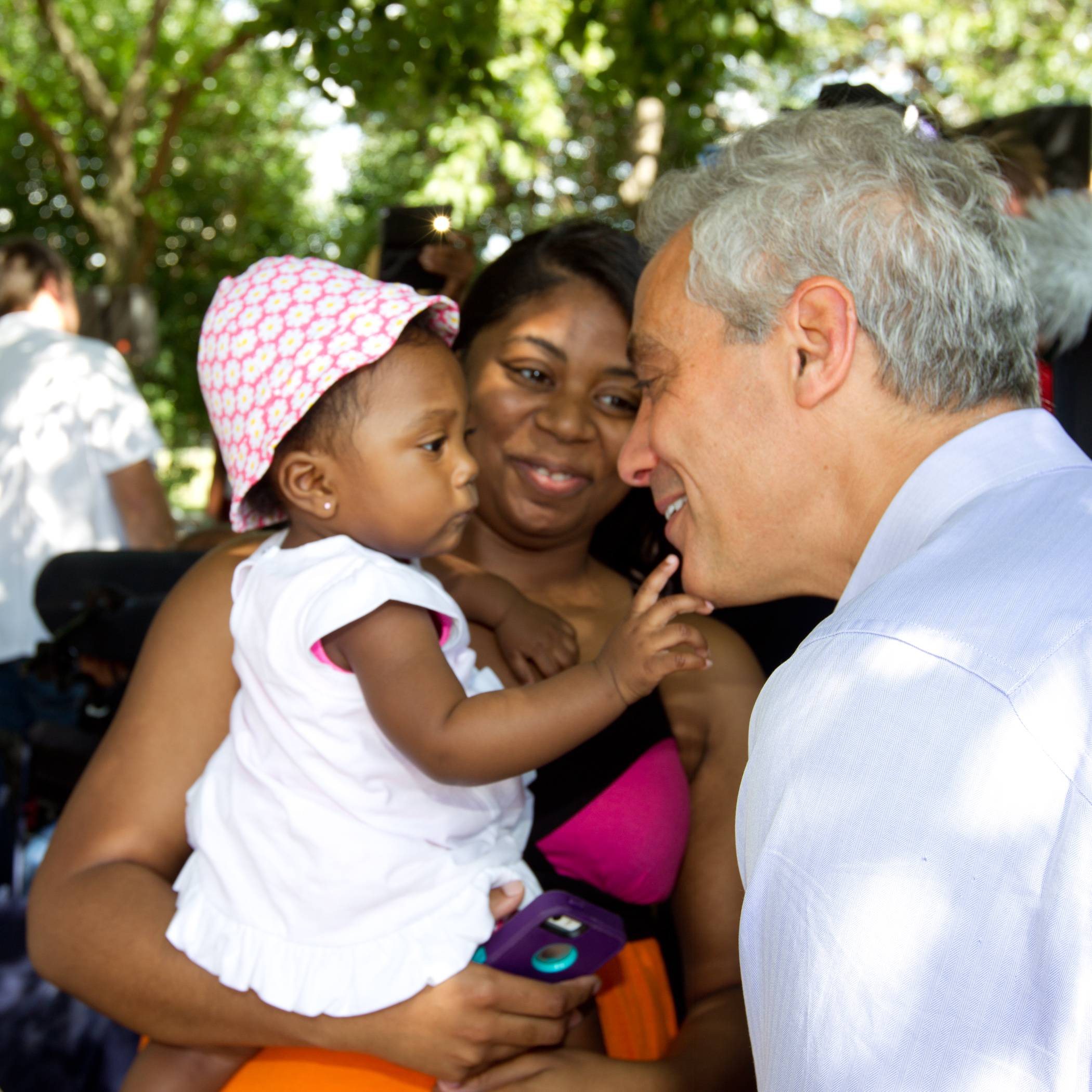 Mayor Emanuel joins Bronzeville community members as they cerebrate the opening of a new playground at Anderson Park.