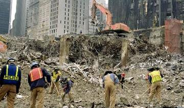 Recover - Image of the site of a disaster, and a cleanup crew
