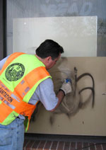 Streets and Sanitation Worker Wipes Away Graffiti