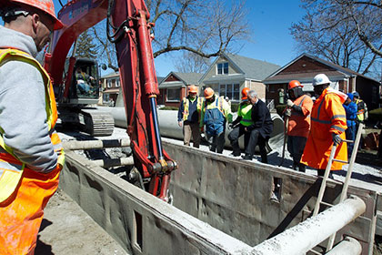 Mayor Emanuel visits with a DWM sewer construction crew