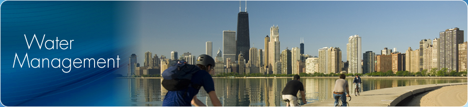 Lake Front image of Chicago skyline and Lake Michigan with bicyclist riding enjoying the day.
