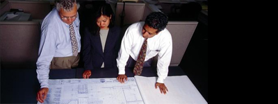 Administrative Reviews and Approvals: People reviewing building plans