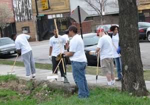 Several People Cleaning Streets with Brooms
