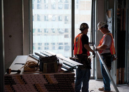 photo of 2 workers in a construction building project