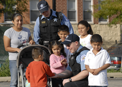 Family with Police Officer Image